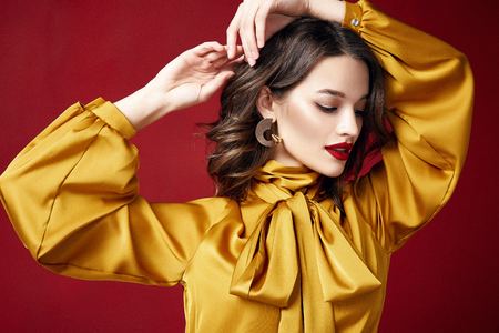 Portrait beautiful sexy pretty woman red lipstick jewelry earrings brunette hair cosmetic makeup fashion clothes beauty salon happy holidays merry Christmas Eve New Year St. Valentine's Day party. Zdjęcie Seryjne