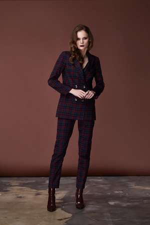 Fashion style woman perfect body shape brunette hair wear dark suit jacket pants blouse elegance casual beautiful model secretary hostess diplomatic protocol office uniform formal business lady.