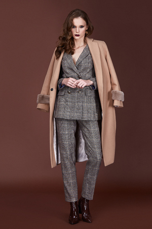 Beautiful sexy woman wear for meeting date business style suit jacket pants cashmere coat accessory fashion collection shoes model pose long brunette hair natural make up businesswoman casual clothes.