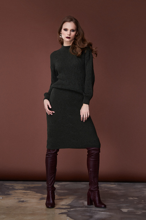Sexy beauty woman pretty face tan skin wear dark green knitted suit dress long skinny body shape makeup cosmetic collection studio catalog brunette accessory clothes for office party fashion.