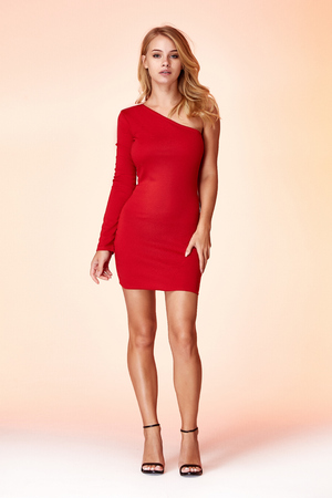 Fashion style woman perfect body shape blond hair wear red skinny short dress elegance casual beautiful model secretary office uniform stewardess business lady party date jewelry earrings shoes.