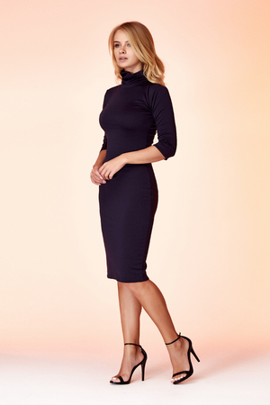 Beauty woman model wear stylish design trend clothing black skinny dress casual formal office style for work meeting walk party blond hair makeup party businesswoman secretary diplomatic protocol.