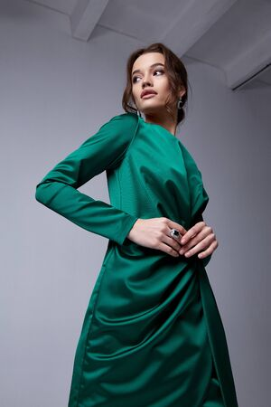 Beautiful young woman thin slim figure evening makeup fashionable stylish dress clothing collection, brunette, green silk bows holiday party birthday New Year Christmas Valentine's Day.