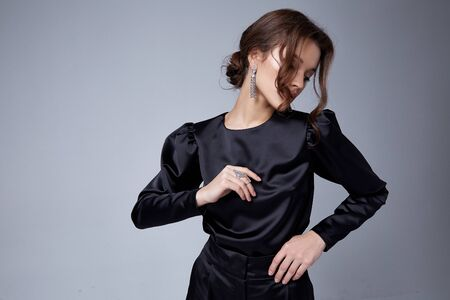 Sexy beautiful woman fashion glamour model brunette hair makeup wear black suit trousers jacket clothes office dress code casual party style accessory date walk girl skinny body shape studio.