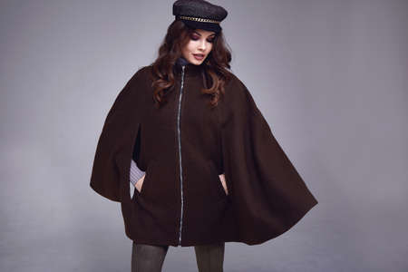 Sexy beautiful woman dark brunette hair wear clothes pants jacket coat trend accessory hat makeup perfect body model fashion office style businesswoman natural beauty casual elegant design formal. Stock fotó