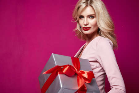 Sexy pretty lady fashion model beautiful woman wear style skinny knitted dress celebration happy holidays merry Christmas Eve New Year party St. Valentine's Day hold gift box present surprise makeup.