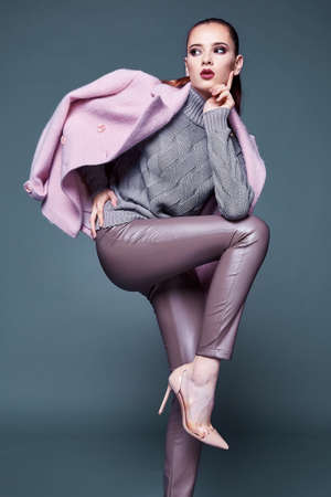 Woman wear business style clothing for office casual meeting outwear cashmere coat pink wool knitted sweater lather skinny pants fall collection casual formal for office beautiful face model glamor.