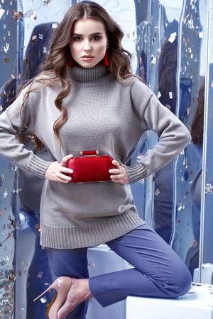 Beautiful sexy young business woman brunette hair luxury chic wear casual style for office gray organic sweater trousers pretty face spring winter collection glamor model fashion clothes jewelry bag.