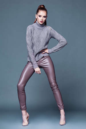 Beautiful sexy pretty woman perfect body shape face makeup wear lilac wool cashmere sweater and skinny lather pants shoes accessory casual clothes for party walk brunette hair fashion style.