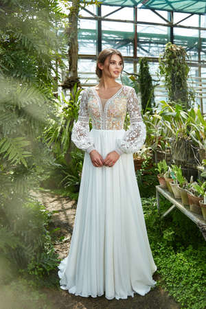 Beautiful woman bride fashion model brunette hair bright makeup pretty wear long silk white dress with lace bridal ceremony wedding espousal in blooming romance garden party marriage happy big day. 版權商用圖片 - 159922565