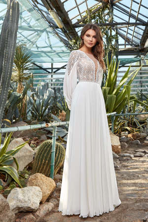 Sexy beautiful woman pretty bride wedding big day marriage ceremony in summer garden wearing long silk and lace white dress bright makeup hairstyle pure love.