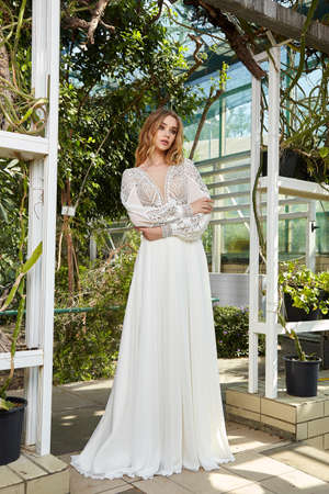 Sexy beautiful woman pretty bride wedding big day marriage ceremony in summer garden wearing long silk and lace white dress bright makeup hairstyle pure love. 版權商用圖片 - 159922756
