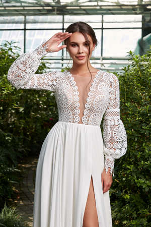 Sexy beautiful woman pretty bride wedding big day marriage ceremony in summer garden wearing long silk and lace white dress bright makeup brunette hairstyle pure love.