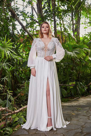 Beautiful woman plus size model bride fashion model blond hair bright makeup wear long silk white dress lace bridal ceremony wedding espousal in blooming garden party marriage accessory. 版權商用圖片 - 161473922