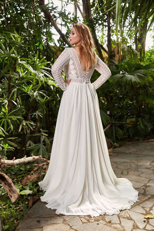 Beautiful woman plus size model bride fashion model blond hair bright makeup wear long silk white dress lace bridal ceremony wedding espousal in blooming garden party marriage accessory. 版權商用圖片 - 161473938
