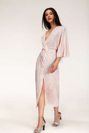 Pretty sexy beautiful woman long brunette dark hair glamor luxury life style wear midi long light dress style for party date celebration evening accessory jewelry fashion designer clothes studio.
