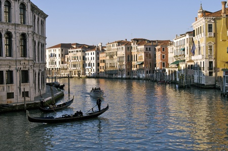 Gondolas cruzing the Venice canals in the afternoon photo