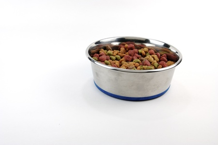 Dog food in a bowl on white  background Stock Photo - 8900047