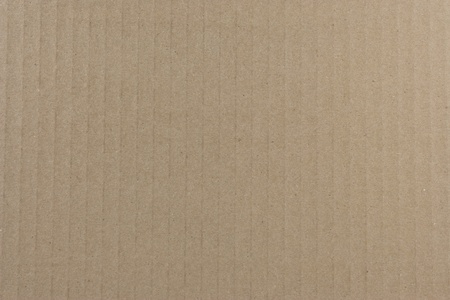 Light brown corrugated cardboard texture background photo