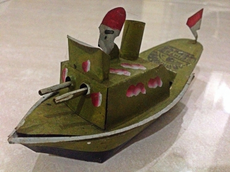 Made from Zinc this toy is an Indonesian Traditional Toy the boat will move if you pour it with oil and burn the oil inside a sample of 2D  3D square triangle and circle in a form of a toy Stock Photo