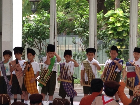 Kids play Music Composition using Angklung an Indonesian Traditional Music Instrument