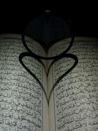 Al Quran and the shadow of love. Stock Photo - 11118865