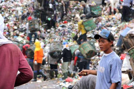 dumpster: a man working as trash monger in Bantar Gebang dumpster, Jakarta, Indonesia Editorial