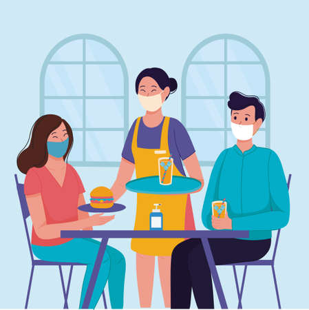 Waitress wearing a mask and serving the restaurant's guests. Applying safety measures Covid-19 or coronavirus