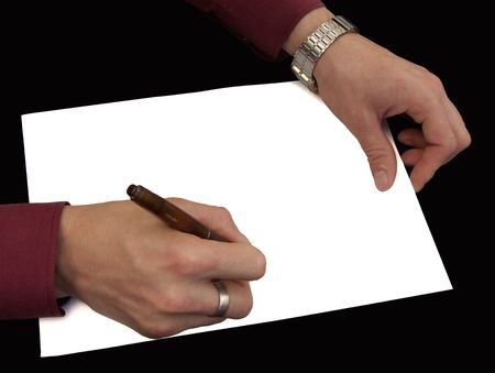 White leaf of a paper on a black background. Hands with the handle on a white leaf.