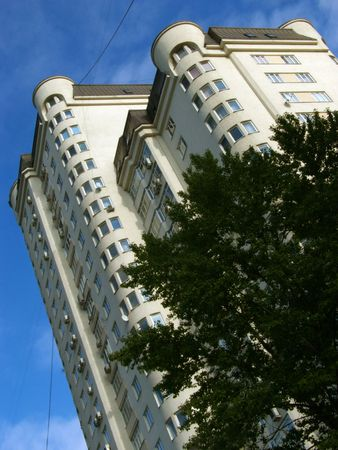 High building on a background of the sky. Distortion by prospect. Stock Photo