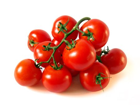 A lot of red tomatoes is on a white background. Stock Photo