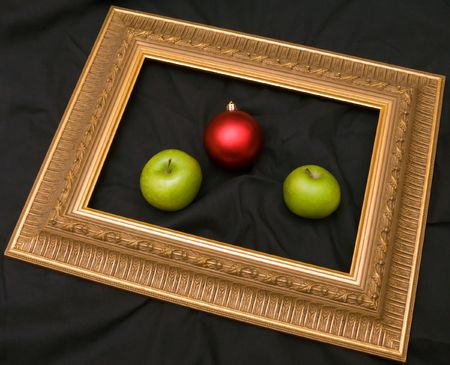Two apples and fir-tree marble are in a frame.