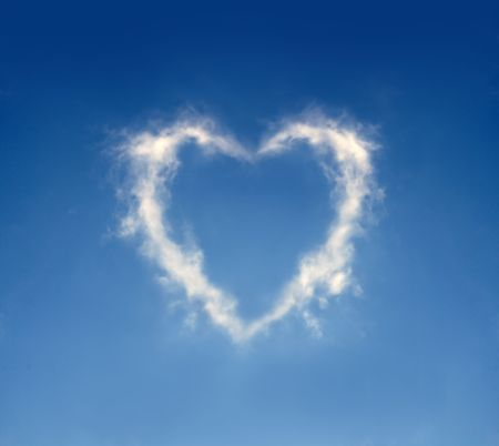 The cloud in the form of heart against a blue sky. To the Valentines Day joke.