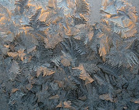 Frost patterns on the window. Winter morning.
