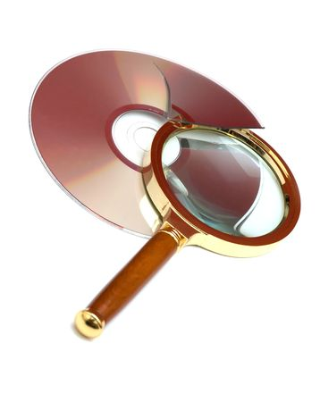 Magnifier and broken CD. Finding Bugs record Stock Photo