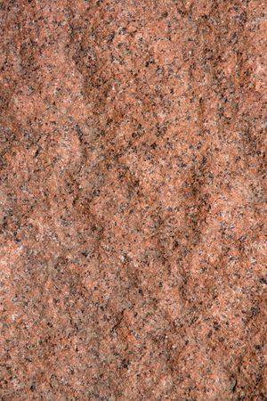 Raw rough Stone - pink granite. Abstract background. Stock Photo