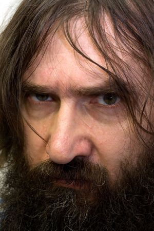 Mysterious Russian soul. A man with a beard and heavy eye.