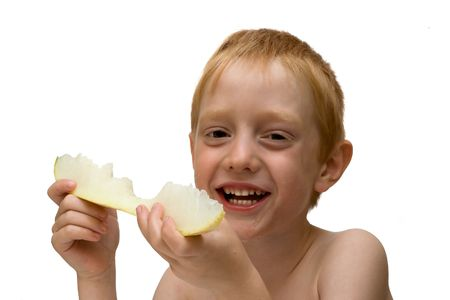 The boy eat a piece of juicy melons. Isolated on white background.