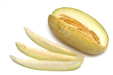 Yellow melon on a white background. Three slices melon. Stock Photo