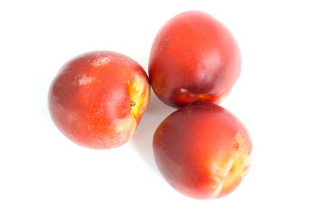 Three fruit nectarines. On a white background. Stock Photo - 3390792