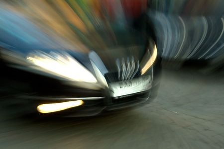Car was going fast on city roads. Blurred Motion. Stock Photo