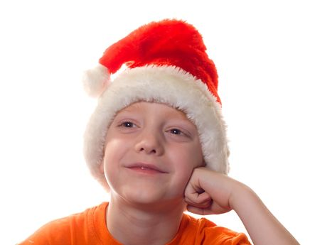 Boy in Santa cap on a white background. Stock Photo