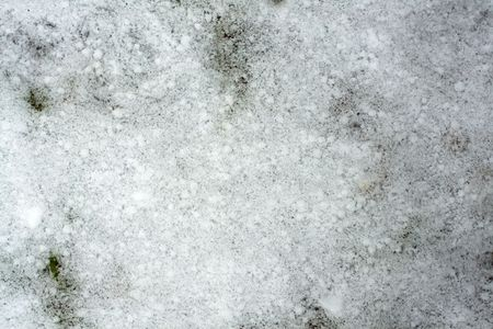 A thin layer of fresh snow on the ground. Background. Stock Photo