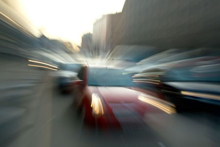 Red car was going fast on city roads. Blurred Motion.