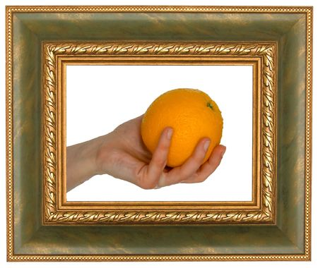 Hand holding an orange in the frame. On a white background.