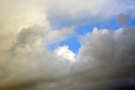 Disturbing clouds on blue sky. Wind.  Stock Photo