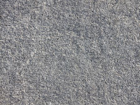 Grey rough granite. The background for the designer.