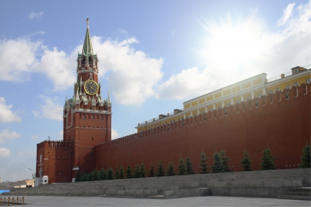 Bright sunshine over the Moscow Kremlin. Clear sky and a dazzling cloud. Stock Photo