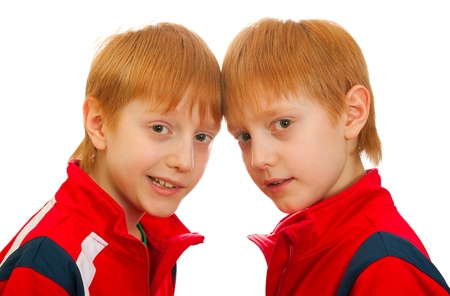 Two twin boys watching. red 10 years