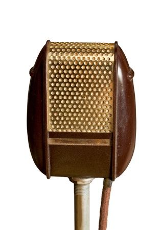 Ancient golden - brown microphone isolated on white background.